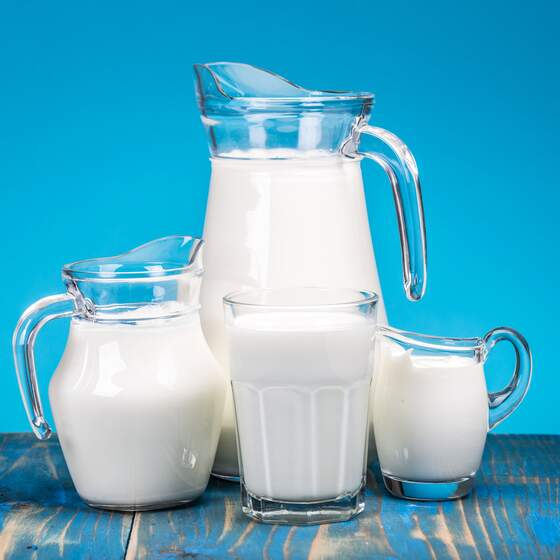 Milk concept on a blue background